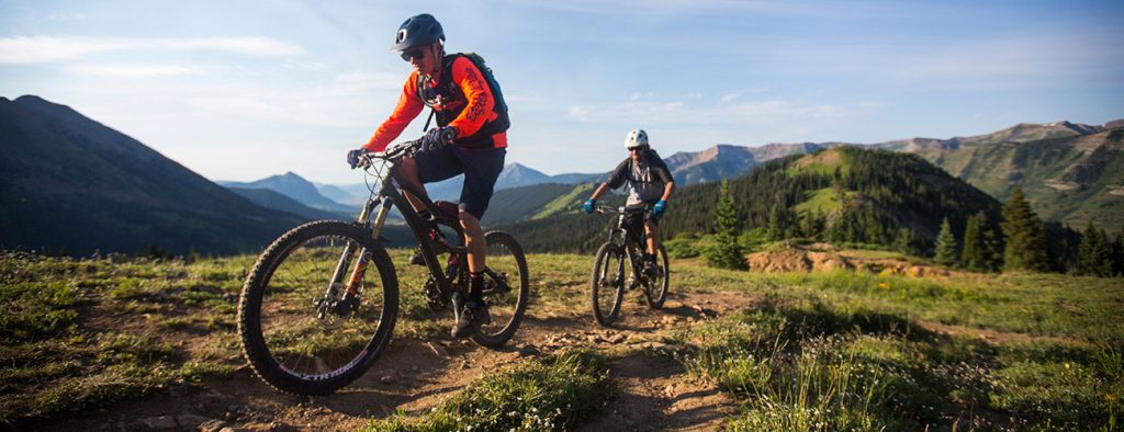 two riders climbing Trail 403 in the morning light, Crested Butte, CO
