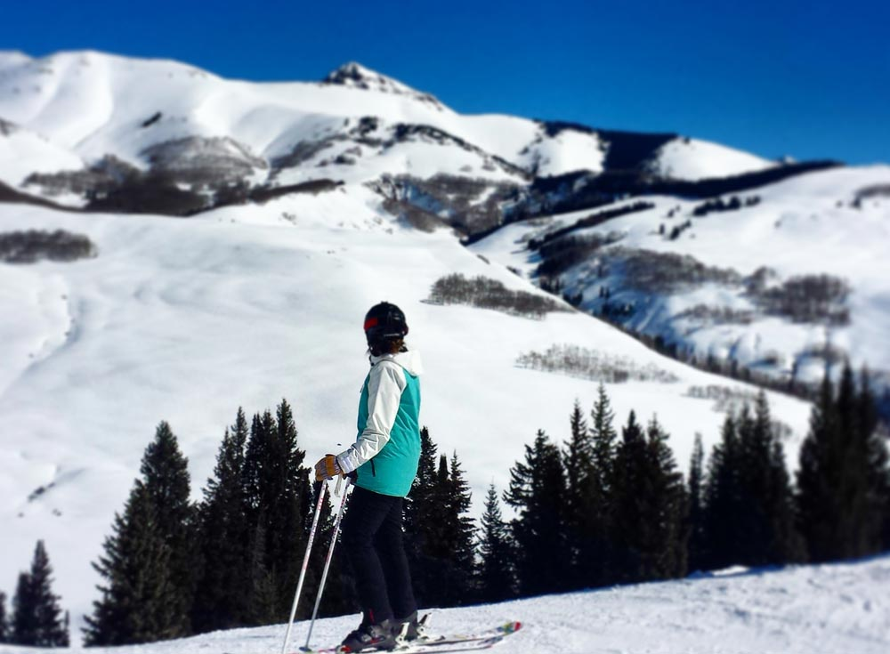 Spring skiing weather in Crested Butte on a bluebird day means lots of sun