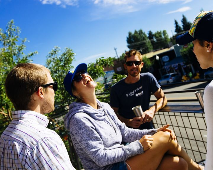 group relaxing on a deck on Gunnison's main street