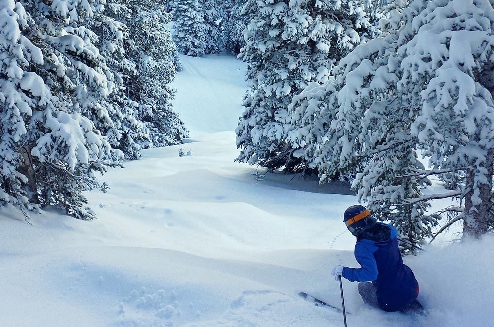 Skier in untouched powder snow at Crested Butte Mountain Resort