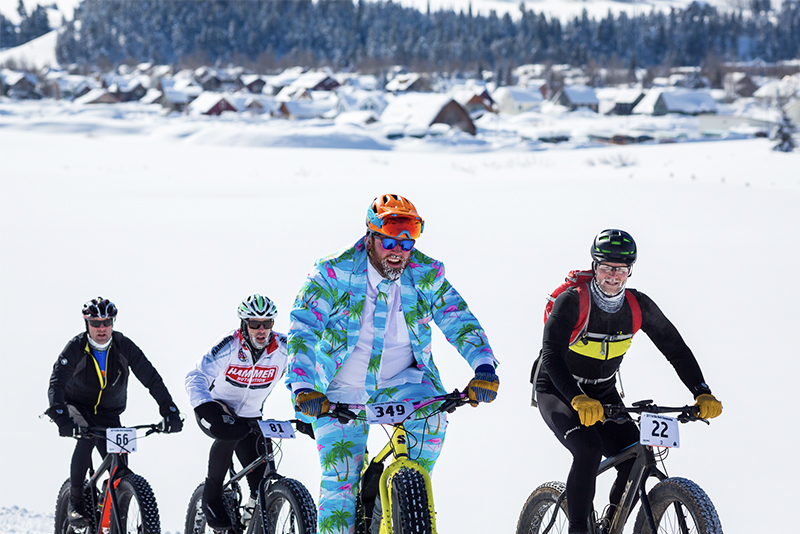 Fat tire bikers riding through snow in Crested Butte Colorado