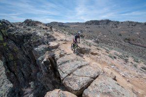 Mountain bikers climb up The Ridge trail at Hartman Rocks in Gunnison in summer.