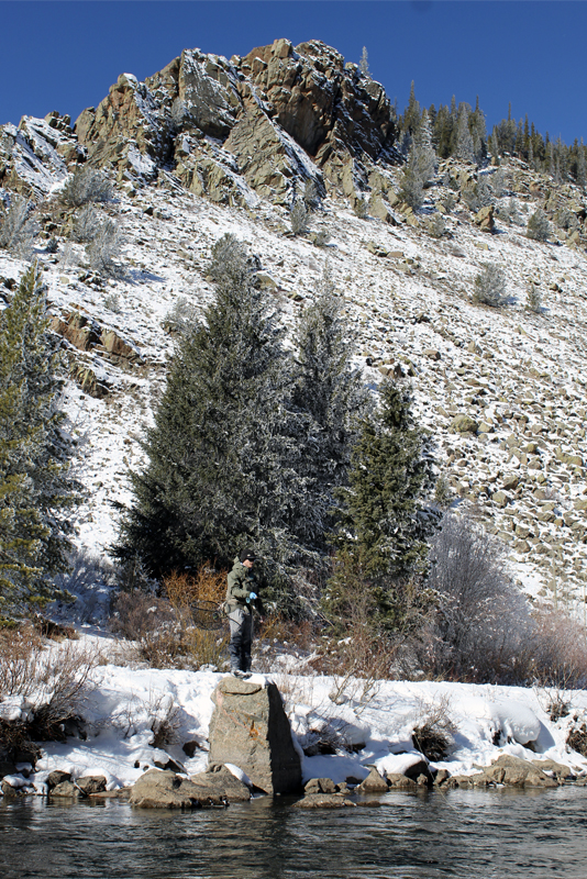 A man fly fishes in winter in the Gunnison area.