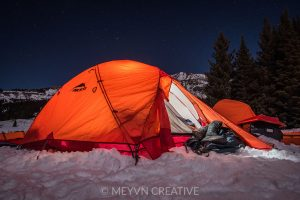 Winter camping tent on a starry night near Lake Irwin, Gunnison County, CO.