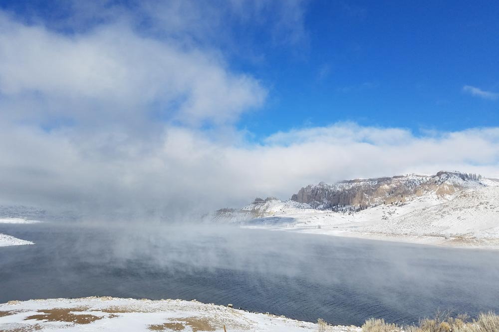 Blue Mesa Reservoir with mist rising over it