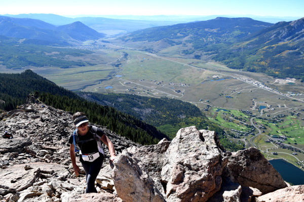 topping out on the summit of crested butte mountain during the park to peak to pint