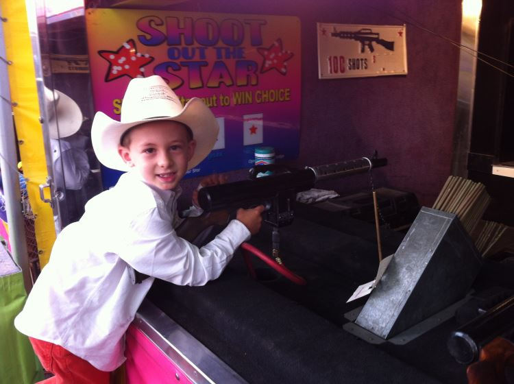 Kid playing Carnival Game at the rodeo in Gunnison, Colorado